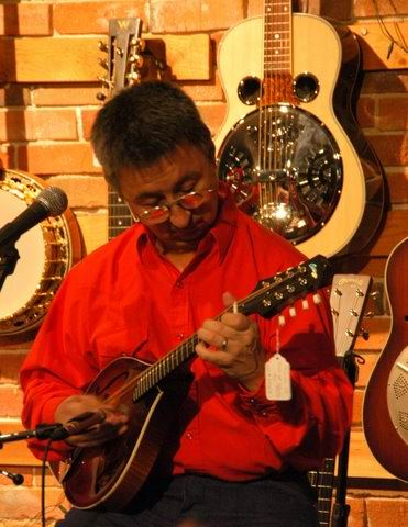 playing mandolin at Olde Town Pickin'                           Parlor: Ernie Martinez: Bands, Singers,                           Songwriters / Composers, Solo Performers,                           Sidemen, Instrumentalists, Performers,                           Entertainers, Musicians