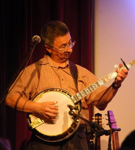 another banjo: Ernie Martinez: Bands,                           Singers, Songwriters / Composers, Solo                           Performers, Sidemen, Instrumentalists,                           Performers, Entertainers, Musicians