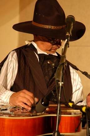 cowboy playing dobro: Ernie Martinez:                           Bands, Singers, Songwriters / Composers, Solo                           Performers, Sidemen, Instrumentalists,                           Performers, Entertainers, Musicians